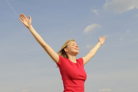 happy young woman spreads her arms Stock Photo