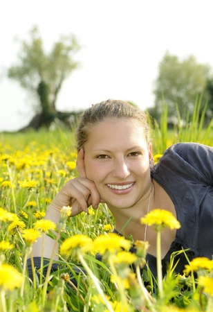 young woman on a flower meadow Stock Photo - 9519109