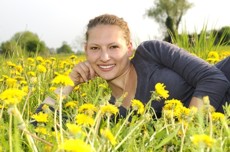 young woman on a flower meadow Stock Photo - 9519159