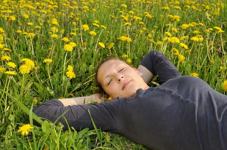 young woman lies on a flower meadow Stock Photo - 9519176