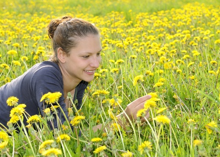 young woman on a flower meadow Stock Photo - 9519134