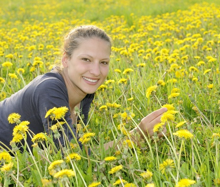 young woman on a flower meadow Stock Photo - 9519126