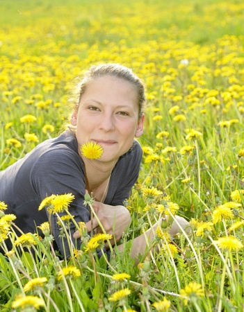 young woman on a flower meadow Stock Photo - 9519117