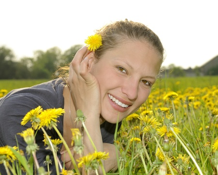 young woman on a flower meadow Stock Photo - 9519105