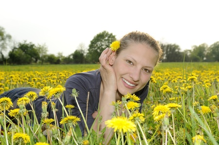 young woman on a flower meadow Stock Photo - 9519108