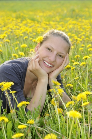 young woman on a flower meadow Stock Photo - 9519130