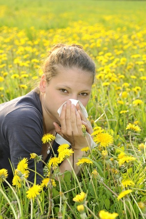 young woman with handkerchief on a meadow photo