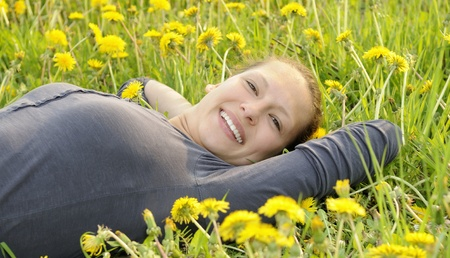 young woman lies on a flower meadow Stock Photo - 9519124