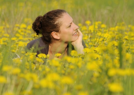 young woman on a flower meadow Stock Photo - 9519107