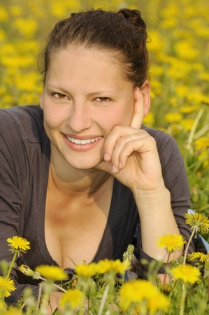 young woman on a flower meadow Stock Photo - 9519131