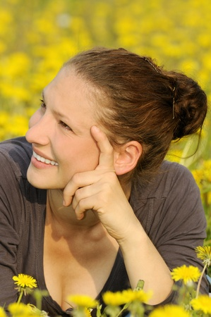 young woman on a flower meadow Stock Photo - 9519132