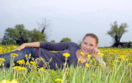 young woman on a flower meadow Stock Photo - 9519112