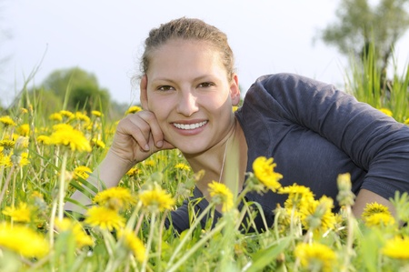 young woman on a flower meadow Stock Photo - 9519122