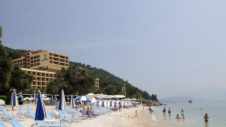 corfu, greece, june 29, 2011: holidays at the nissaki beach on the greek island of corfu