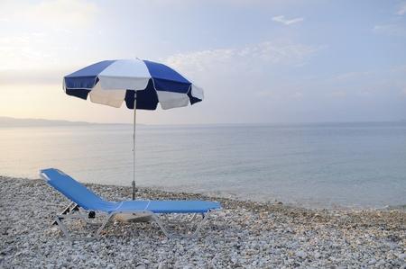 sun chair and umbrella on the beach photo