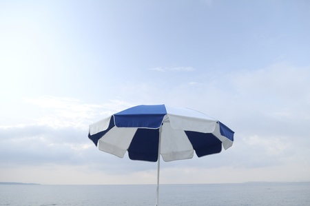 sun chair in front of blue sky photo