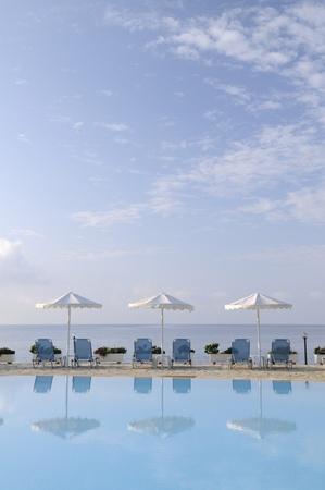 beach umbrellas at swimming pool photo