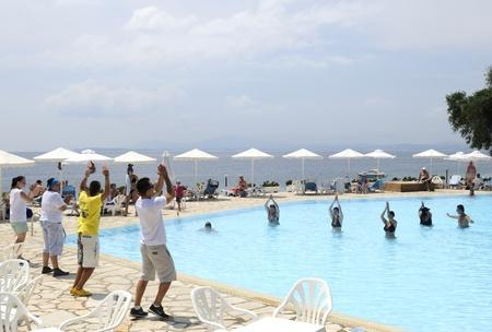 corfu, greece - june 02, 2011: holiday entertainer at the swimming pool, nissaki beach