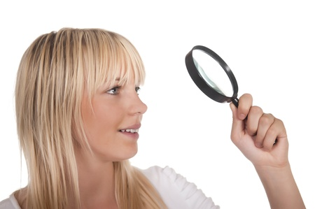 detecting: pretty blond young woman with  magnifying glass