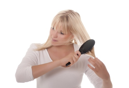 disorderly: young blond woman combing her hair