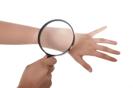 checking: hand, magnifying glass and skin