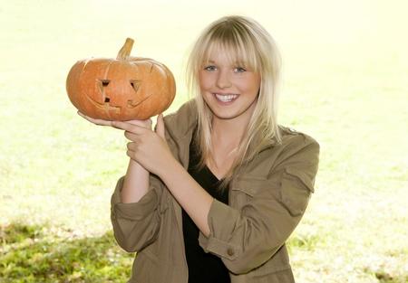 cucurbit: young woman with pumpkin halloween