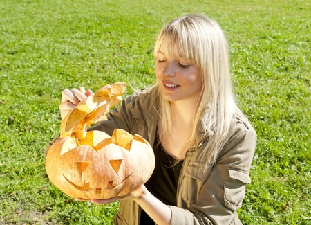 young woman with pumpkin halloween photo