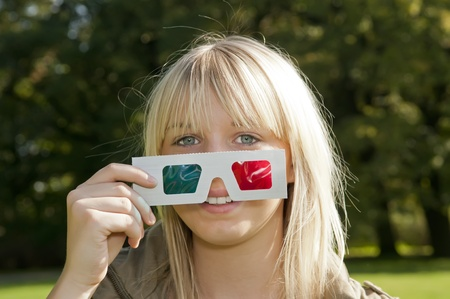 young woman with 3D-glasses photo
