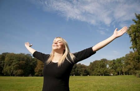 spreads: young woman spreads her arms Stock Photo