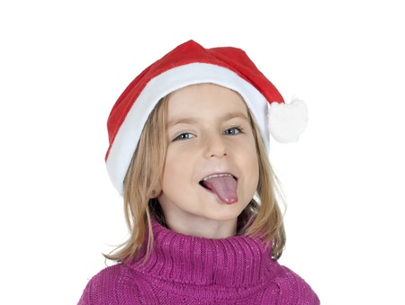 little girl with santa hat puts out her tongue photo