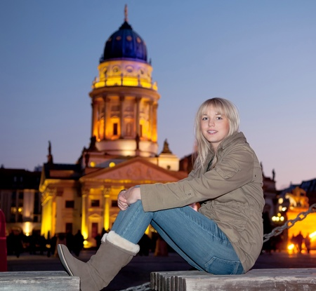 young woman in the city at evening photo