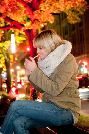 young woman smoking a cigarette photo