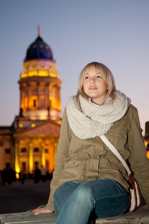 joyfully: young woman in the city at evening Stock Photo