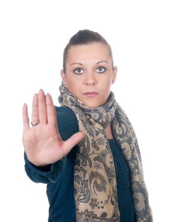 defense: young woman showing stop gesture