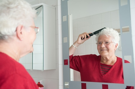 grandma is combing the hair Stock Photo