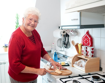 happy old woman in the kitchen photo