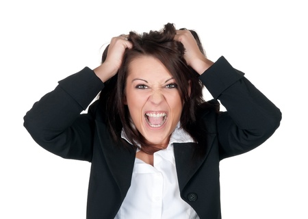 stressed businesswoman ruffles her hair Stock Photo - 12580314