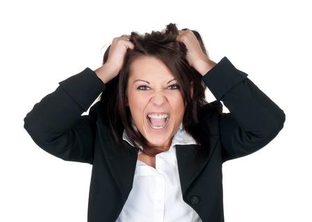 stressed businesswoman ruffles her hair photo