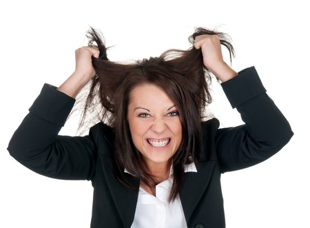 end of a long day: stressed businesswoman ruffles her hair