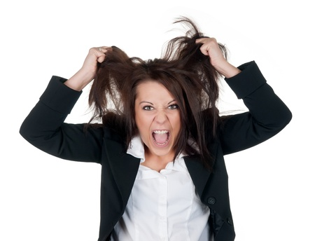 stressed businesswoman ruffles her hair photo