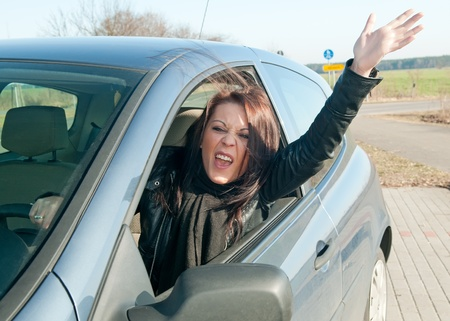 angry young woman screaming in the car Stock Photo - 12986610
