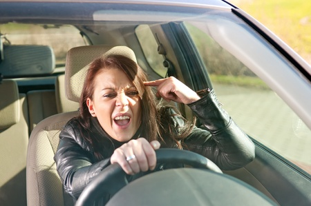 angry young woman gesturing in the car