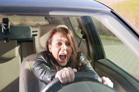 crash car: afraid young woman screaming in the car Stock Photo