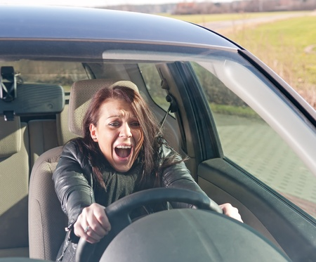 afraid young woman screaming in the car Stock Photo - 12986598