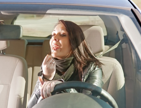 young woman with lipstick in the car Stock Photo - 13153716