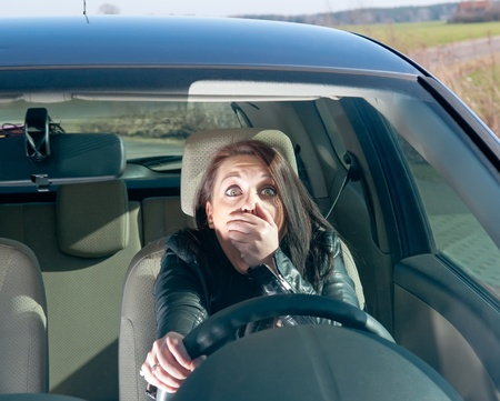 afraid young woman in the car Stock Photo