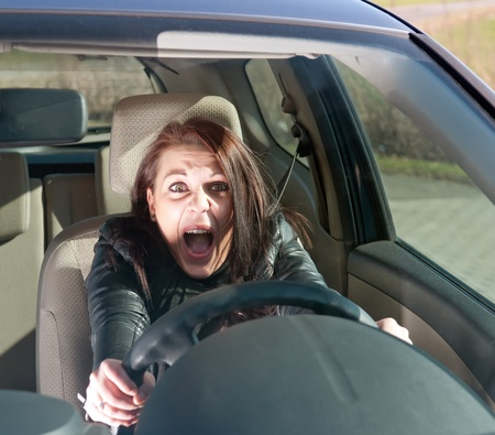 afraid young woman screaming in the car Stock Photo - 12986599