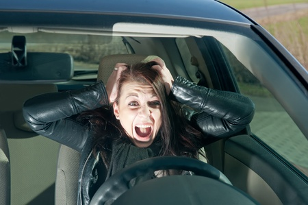 woman screaming: afraid young woman screaming in the car Stock Photo