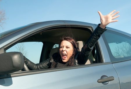 angry young woman screaming in the car Stock Photo - 13107244