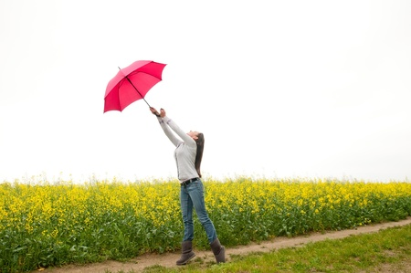 Young woman with umbrella in the wind Stock Photo - 13859542